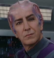 "Alan Rickman as Alexander Dane playing the Spock-like role of Doctor Lazarus from the fictitious ""Galaxy Quest"" science fiction television series."